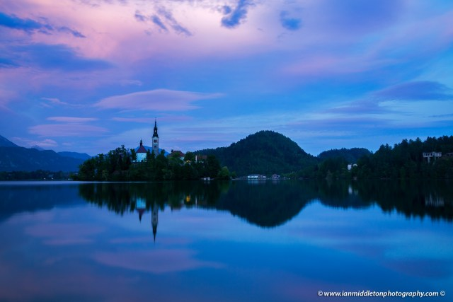 View across the beautiful Lake Bled, island church at sunset, Slovenia. Lake Bled is Slovenia's most popular tourist destination and the Karawanke mountains form the border between Slovenia and Austria.