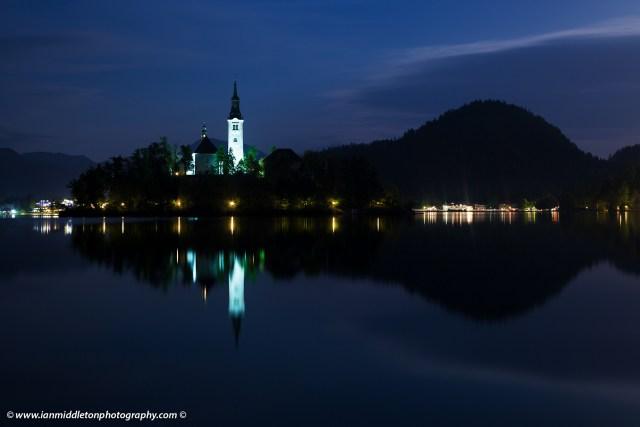 View across the beautiful Lake Bled, island church at dusk, Slovenia.