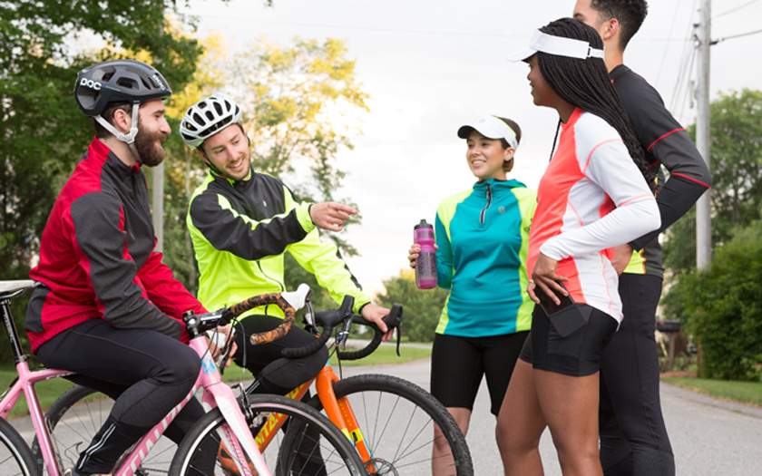 A group of cyclists and runners wearing illumiNITE reflective clothing