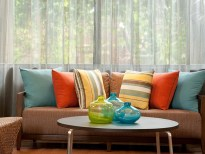 Bright colored throw pillow are attracting to potential renters.
