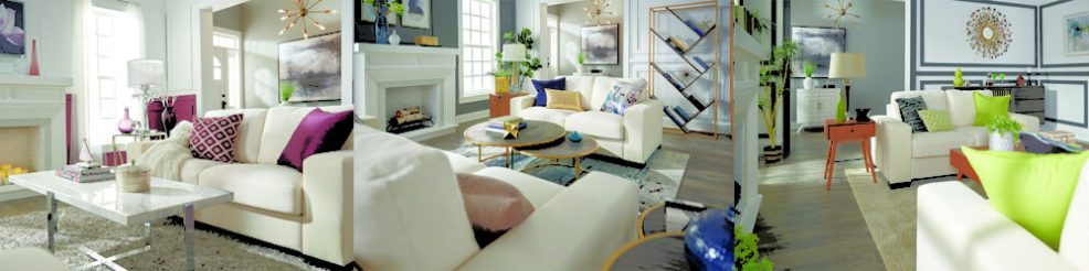 Living room with white couch, purple pillows, blue and gold pillows and green pillows