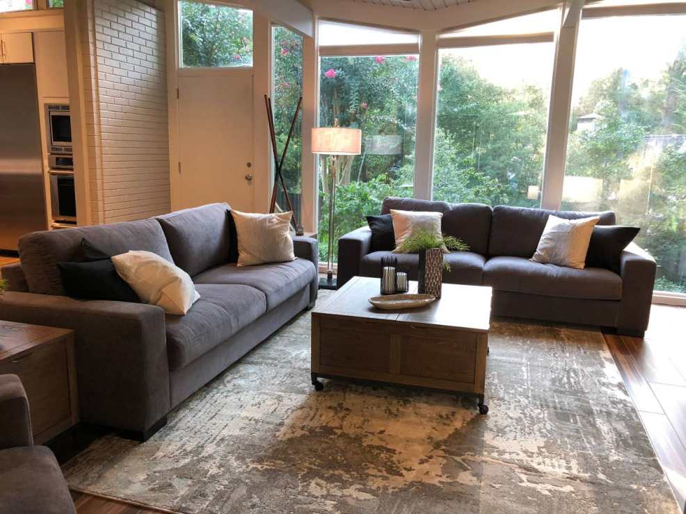 iNSPIRE Q dark grey fabric couches in living room of North Carolina Airbnb