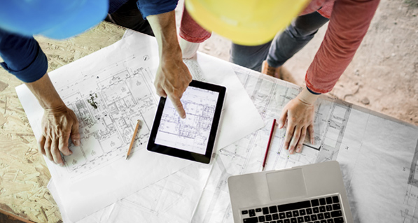 Construction Workers Utilizing Ipad and other Mobile Business Solutions