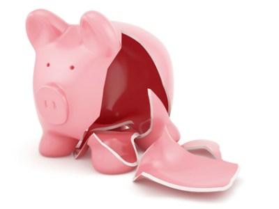 Broken and Empty Piggy Bank Representing Cash Flow Crisis