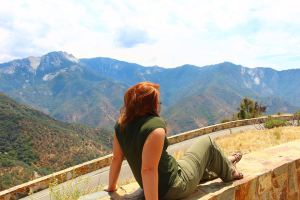 Jacquelyn of A Heavenly Home looking out at mountain vistas at Sequoia National Park in 2015.