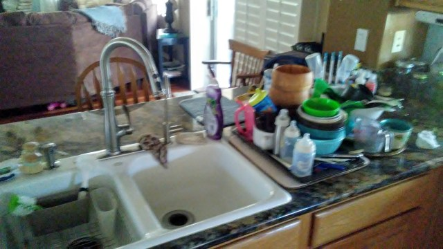 Here the dirty dishes are stacked and the sink empty, cleaned, and ready for tackling this massive job!