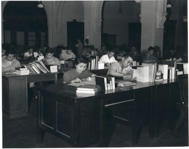 Nisei civilians and soldiers work in the translation and scanning sections, responsible for the translation of all Japanese documents which was vital to the success of the occupation.