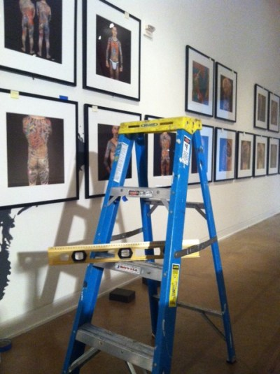 As the photographs are hung