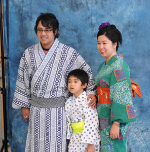 A family poses in traditional garb at JANM's 2013 Natsumatsuri photo booth. Photo: Daryl Kobayashi.