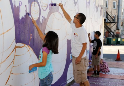 Members of the community helped to paint the mural during JANM's November Target Free Family Saturday.