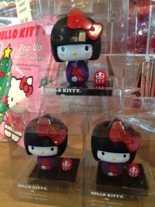 Can you spot Hello Kitty bobblehead's little Daruma friend?