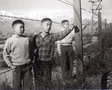 A well-known photograph taken by Toyo Miyatake at Manzanar concentration camp. Courtesy of Alan Miyatake, Toyo Miyatake Studio.