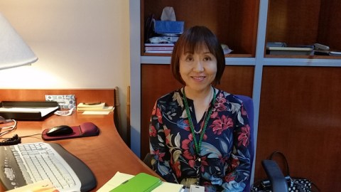 Kyoko Ogawa volunteering at the front desk of the Hirasaki National Resource Center.