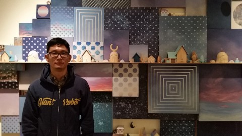 Yoskay Yamamoto in front of his artwork, Wish You Were Here.