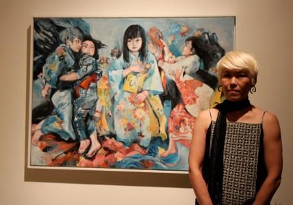 Artist Mari Inukai in front of her painting. Photo by Richard Murakami.