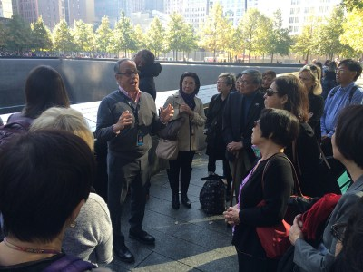 JANM board members listen as Clifford Chanin, Vice President for Education and Public Programs at the National September 11 Memorial and Museum, points out features of the outdoor memorial. Photo by Nicole Miyahara.