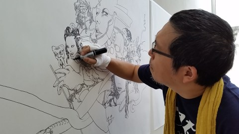 Katsuya Terada at work in the JANM galleries. Photo by Carol Cheh.