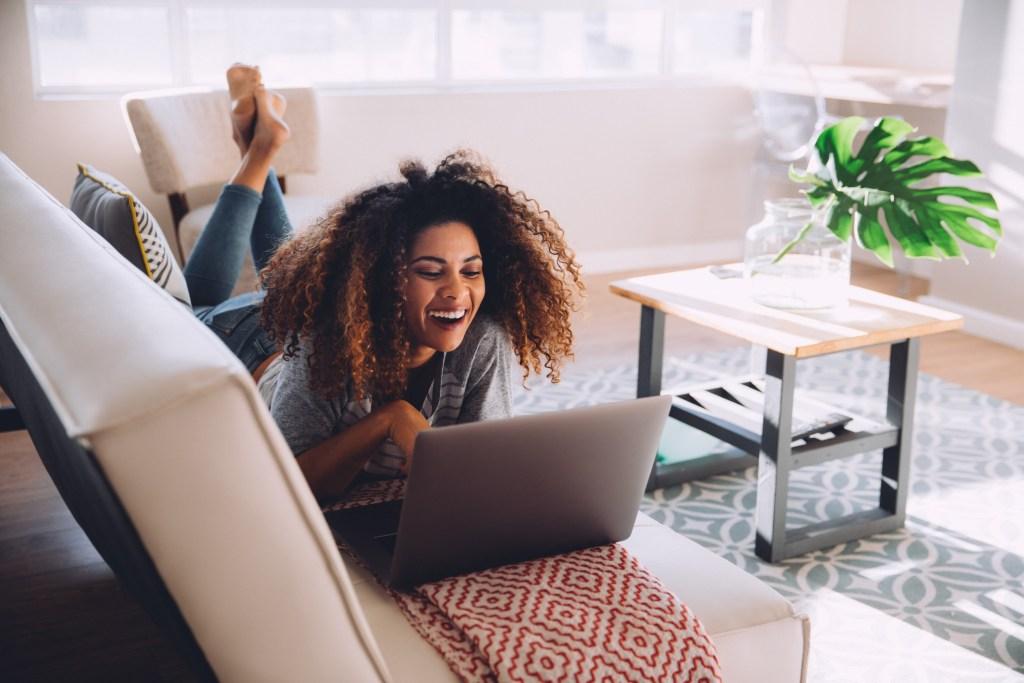 Girl Laughing on Laptop Screen