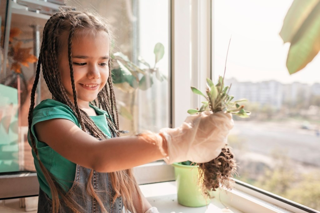 Girl Taking Care of her Plants