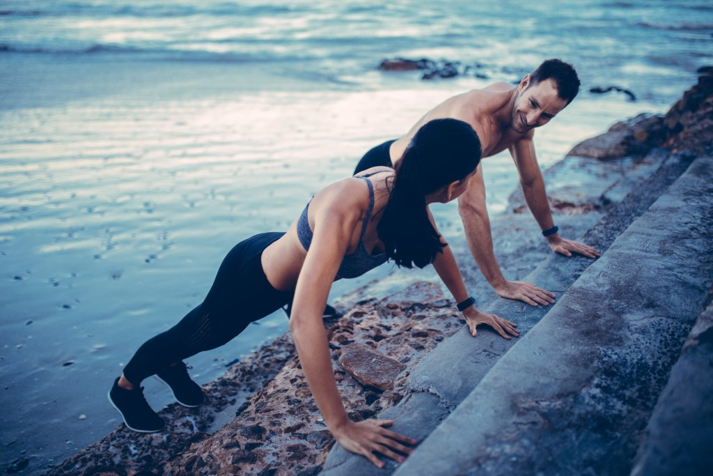 A Couple Doing Pushups