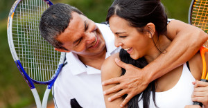 JS Realty Tennis couple flirting at the court and smiling
