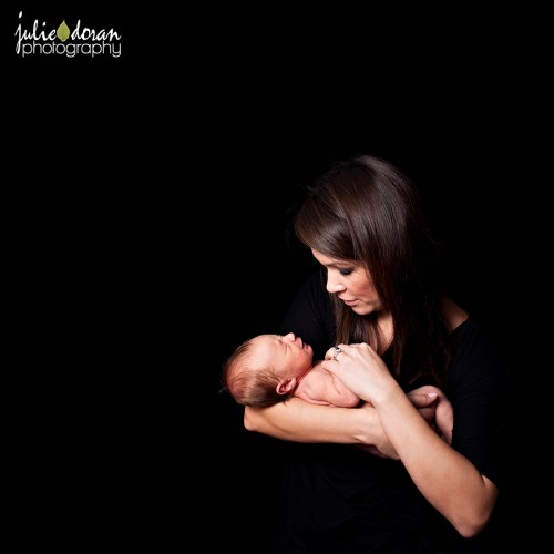 mom holding newborn in arms