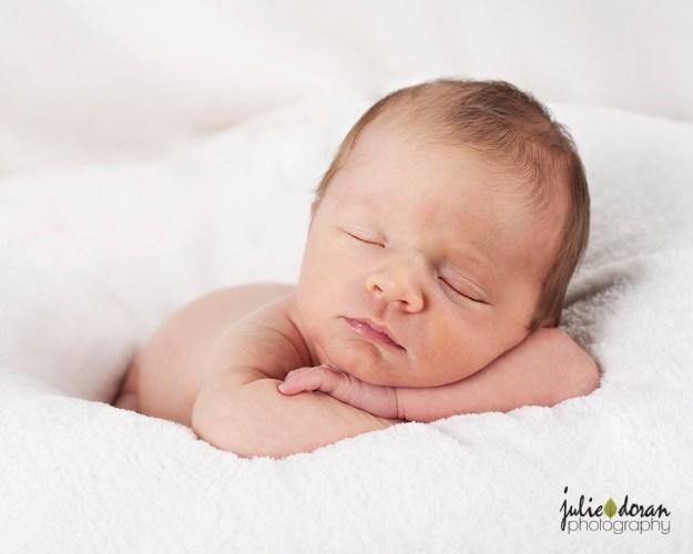 Baby barrett head resting on arms