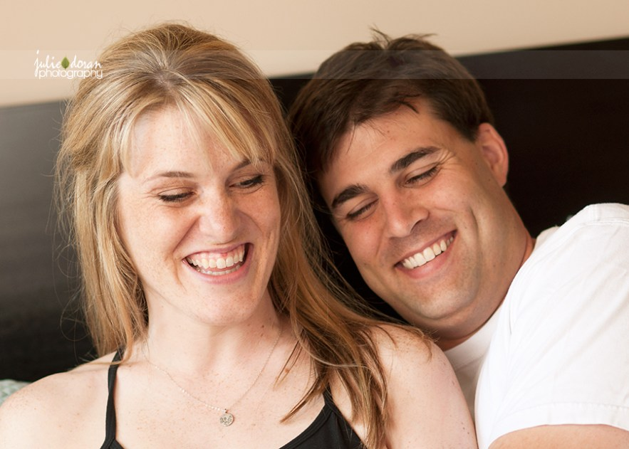 couple_laughing_on_bed