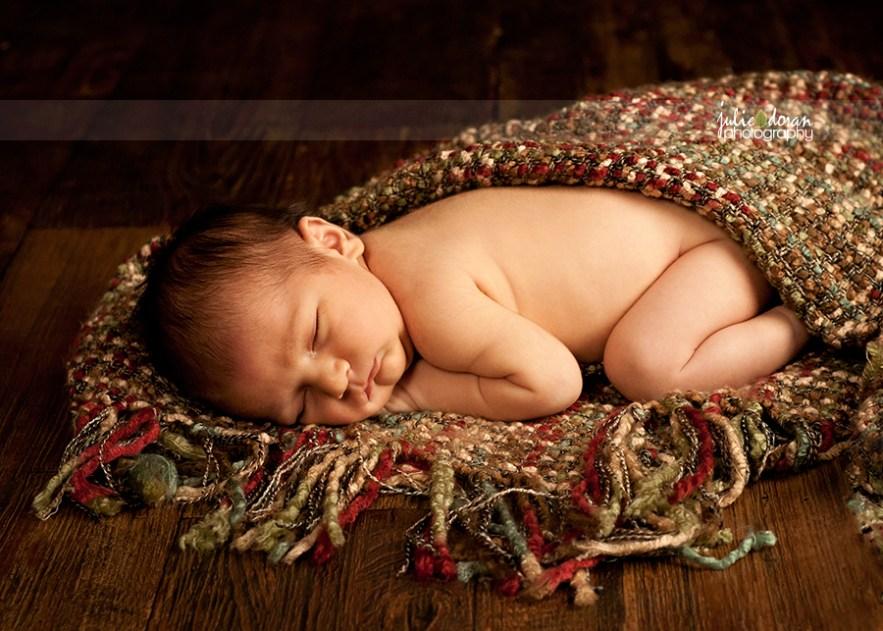 newborn on boucle blanket