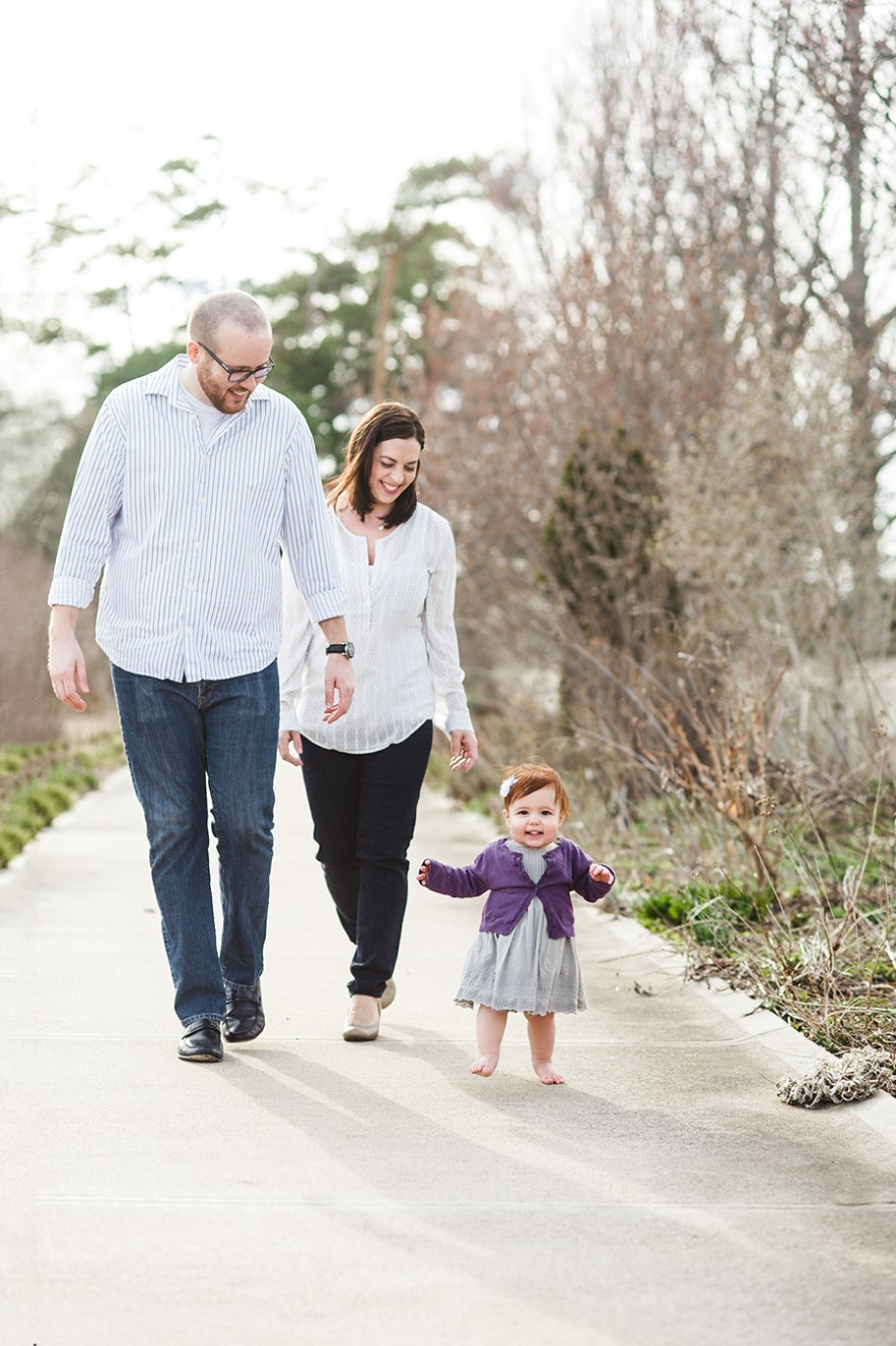 young_family_walking_park