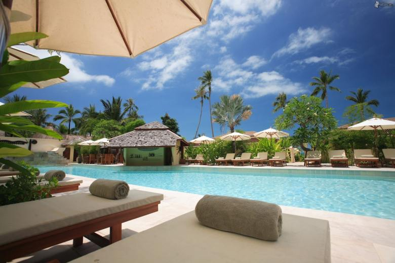 A poolside view at a resort