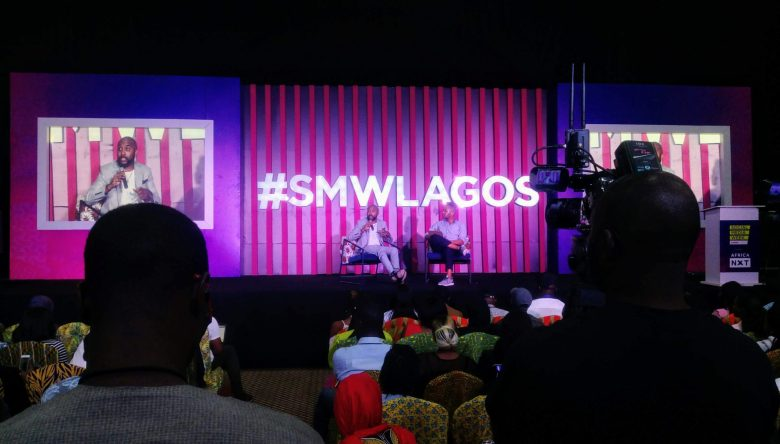 Banky W speaking during a conference at Social Media Week Lagos