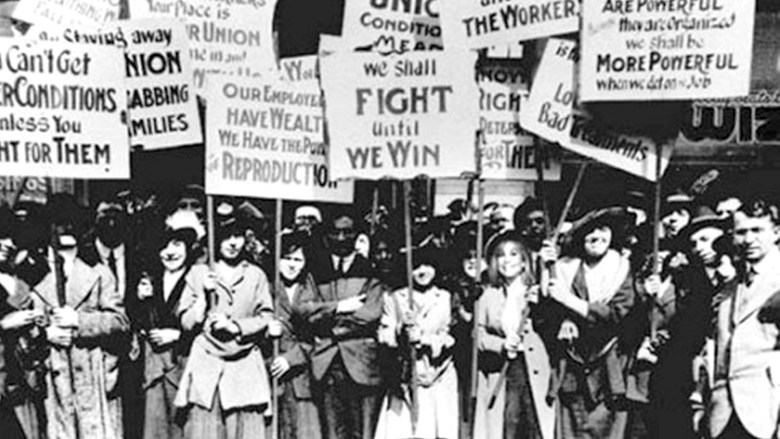 A large group of women (and men) advocating for women's rights