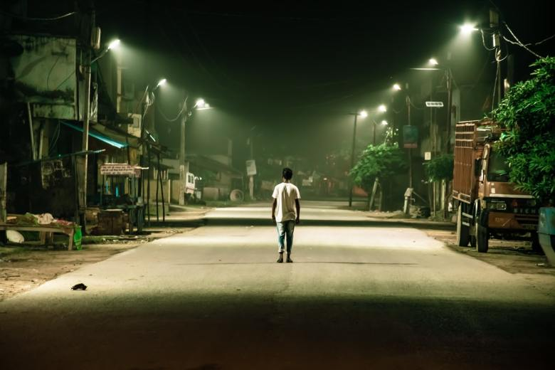Man standing in middle of empty street