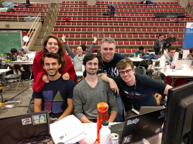 """""""Team Ubuntu"""" shows off their project to Charles Profitt before the project deadline for HackMIT 2016"""