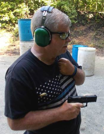 Bob Campbell shooting a Smith and Wesson Shield pistol npr