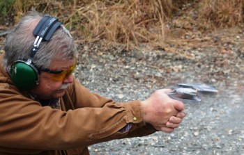 Bob Campbell shooting a Ruger GP100 .357 magnum revolver in recoil