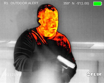Thermal image of an intruder with a pistol