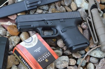 Glock G29 10mm pistol on a bed of river rock