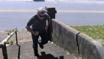 Man running up a flight of stairs