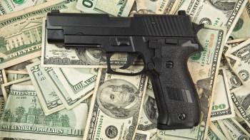 SIG Sauer pistol on 100 dollar bills