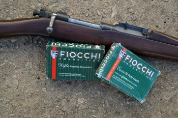 Fiocchi .30-06 ammunition boxes and a Springfield 1903 rifle