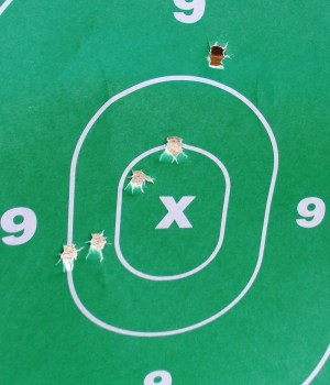 pistol group on a green target