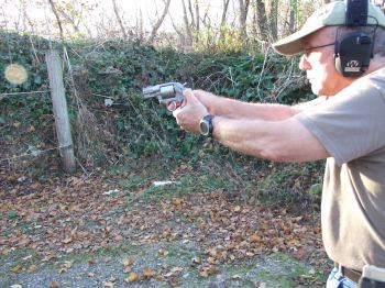 Scott Wagner shooting with a two-handed grip