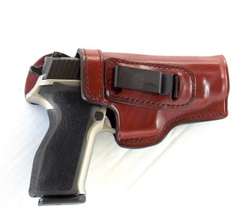 SIG P226 pistol in brown leather Don Hume holster