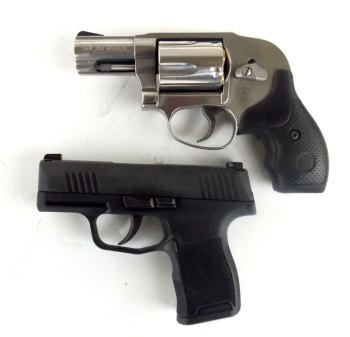 SIG P365 pistol (bottom) compared to a snub nose revolver.