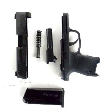 field stripped SIG P365 pistol