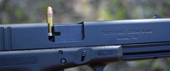 Glock pistol with a stovepipe round sticking out of the top