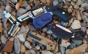 Extrema Ratio Nightmare Karambit with Glock and flashlight with revolver