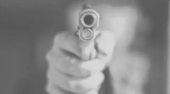 Armed good guy pointing a gun at the camera